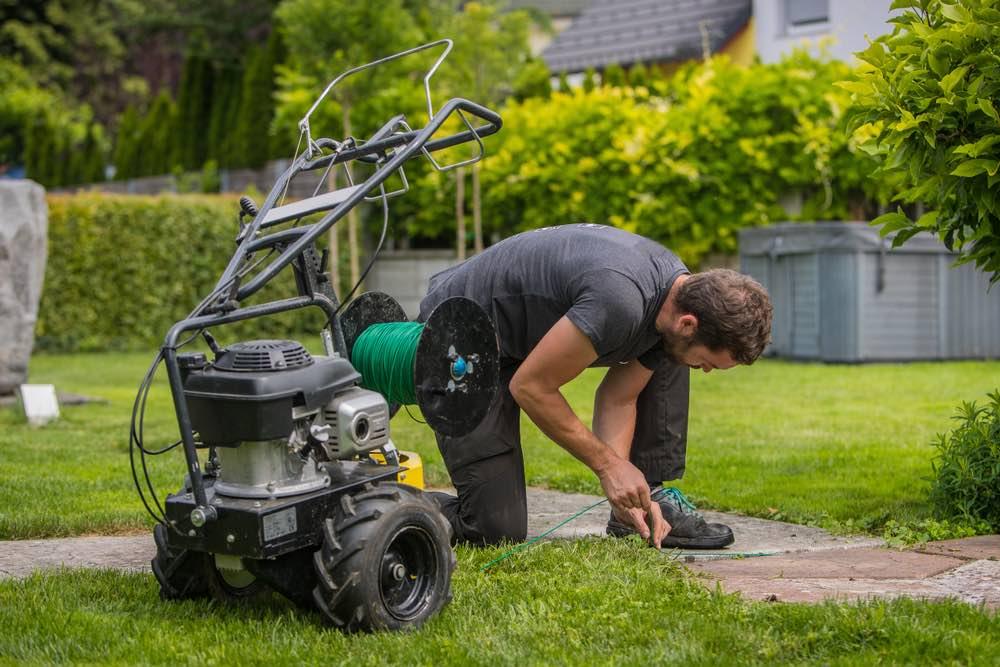 Leggen van grensdraad voor de kwaliteit van robot grasmaaiers